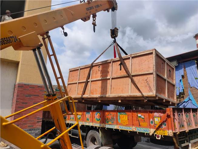 There were around three boxes in all, and each of them was lifted using the crane meticulously